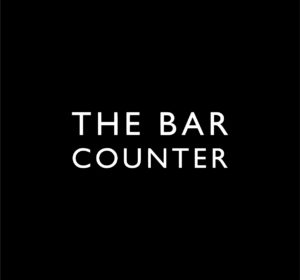 <span>The Bar Counter</span><i>→</i>